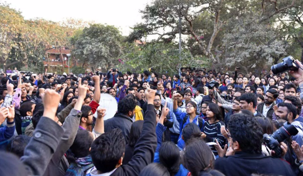 Jawaharlal Nehru University teachers and students form a human chain inside the campus in New Delhi on Feb. 14, 2016, in protest against the arrest of JNU students'-union president Kanhaiya Kumar, who was arrested on sedition charges in connection with an event organized on the campus against the hanging of Afzal Guru