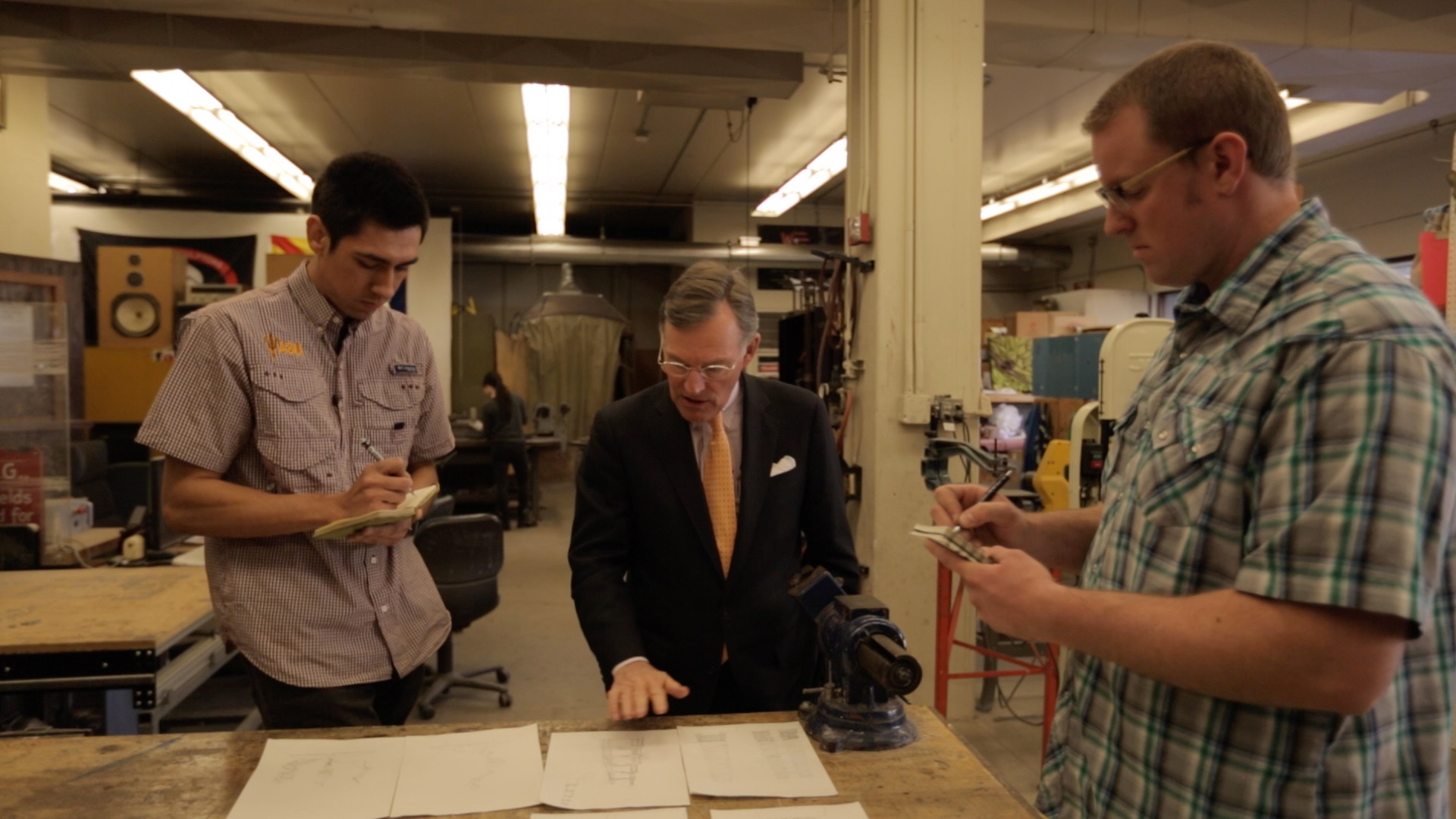 ASU students from the Herberger Institute for Design and the Arts, Miguel Cardona and Chase Young, work with Harold (Terry) McGraw III, former Chairman and CEO of The McGraw-Hill Companies, center, to design this year's McGraw Prize in Education. (Credit: Fervor Creative)