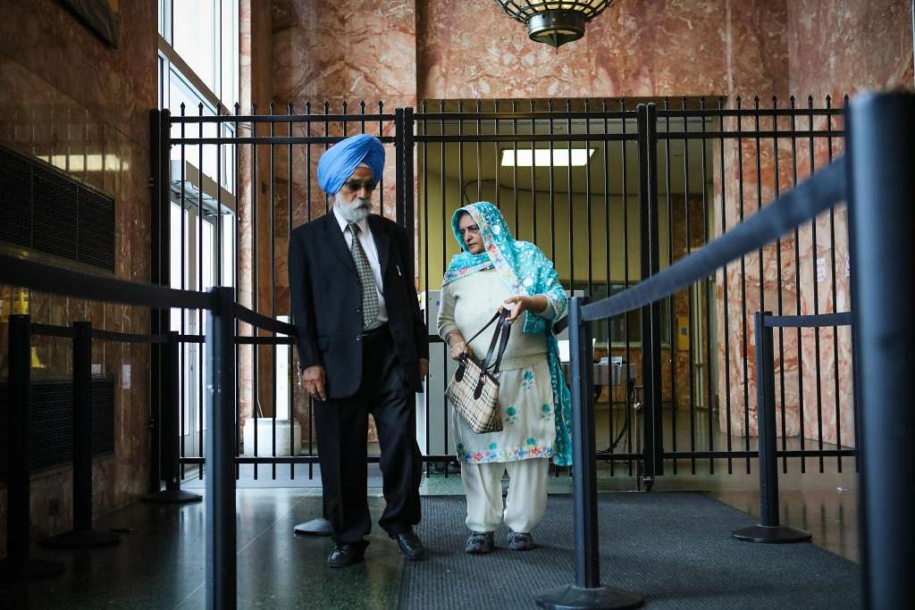 Avtar (left) and Arjinder Chahal, the parents of Gurbaksh Chahal, enter the San Francisco Hall of Justice to attend their son's court hearing on prosecutors' request to revoke his probation.