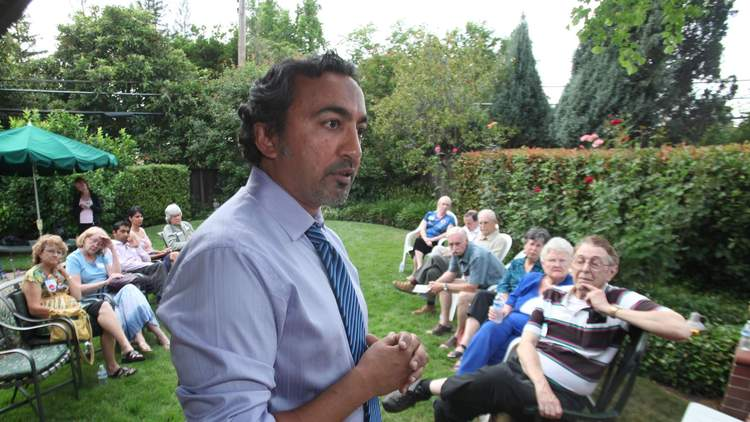 In this 2010 photo, Rep. Ami Bera (D-Elk Grove) addresses supporters at a campaign gathering in Carmichael, Calif. Bera's father has pleaded guility to illegal campaign contributions in 2009 and 2011. (Rich Pedroncelli / AP)
