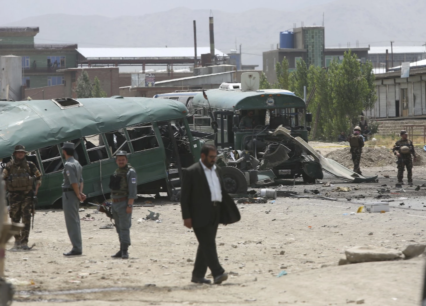 Afghan security forces inspect the site of a suicide attack on the outskirts of Kabul. (Rahmat Gul/AP)