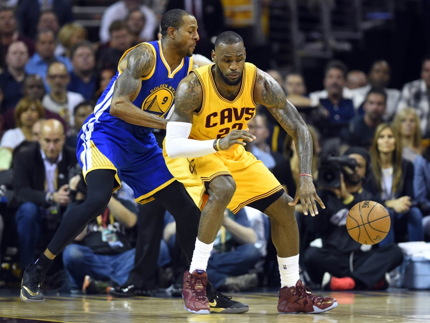 Warriors forward Andre Iguodala guards LeBron James of the Cavaliers.