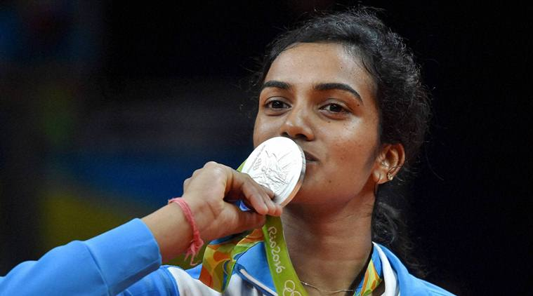 Rio de Janeiro: India's Pusarla V Sindhu kisses her silver medal after her match with Spain's Carolina Marin in women's Singles final at the 2016 Summer Olympics at Rio de Janeiro in Brazil on Friday.