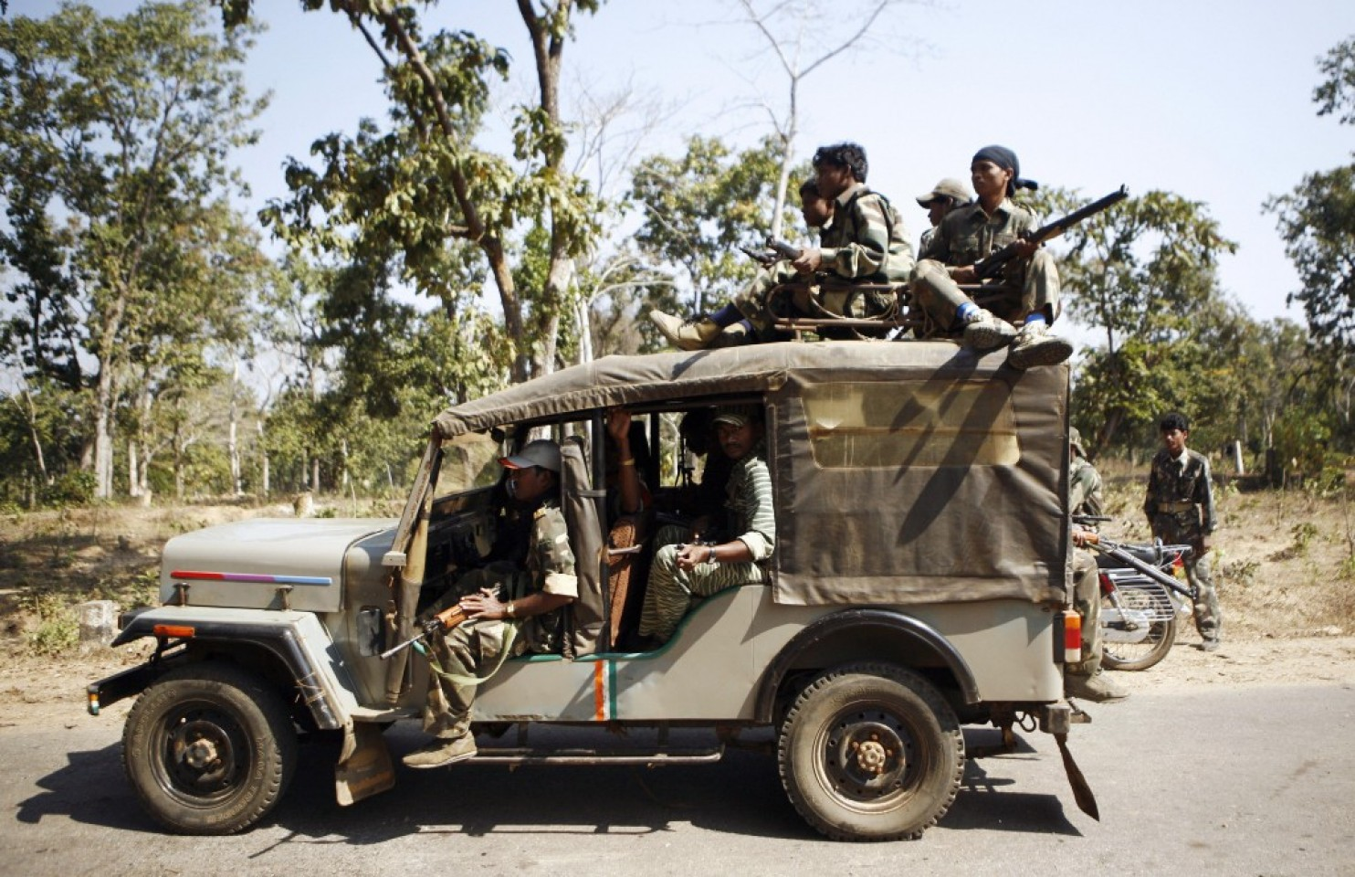 Special Police Officers, or SPOs, travel as part of a convoy of paramilitary forces in Chhattisgarh state in 2008. (Manpreet Romana/Agence France-Presse via Getty Images)