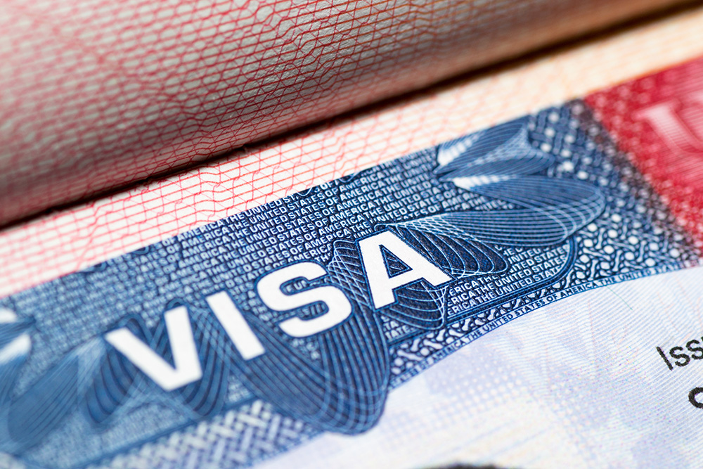 An Indian-American man and his business partner have been arrested for an alleged H-1B visa scam.