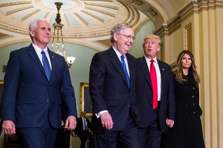 From left, Vice President-elect Mike Pence, Senator Mitch McConnell, President-elect Donald J. Trump and his wife, Melania, on Capitol Hill on Thursday. Mr. McConnell has said that the Trans-Pacific Partnership would not be considered in Congress next week, signaling its demise.