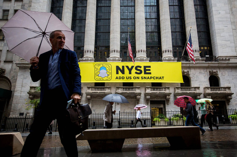 Pedestrians walked past a Snapchat sign outside of the New York Stock Exchange last month in Manhattan. Credit Michael Nagle/Bloomberg