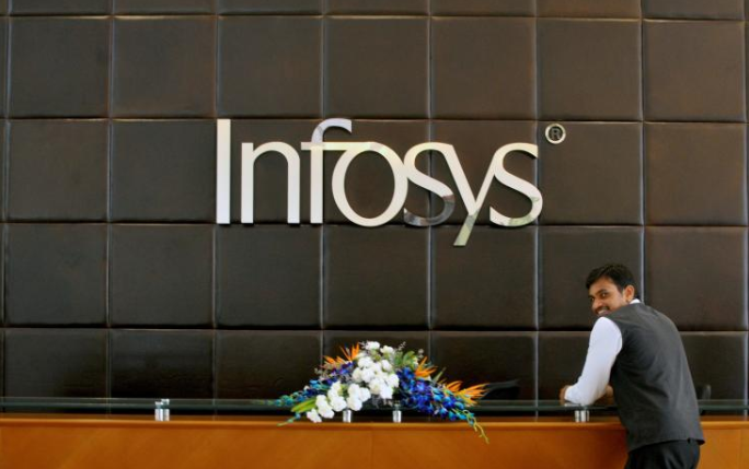 An employee of Infosys stands at the front desk of its headquarters in Bengaluru, India.