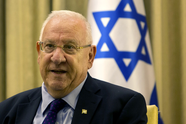 Israel's President Reuven Rivlin speaks during his meeting with New York Gov. Andrew Cuomo, at the President's residence in Jerusalem, Wednesday, Aug. 13, 2014. (AP Photo/Sebastian Scheiner)