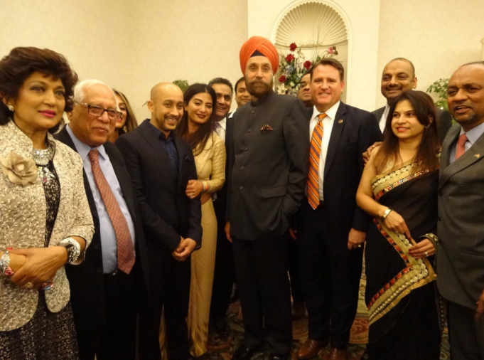 Ambassador Sarna poses for a photo with members of the Indian American community in Fairfax, VA, on Sunday.