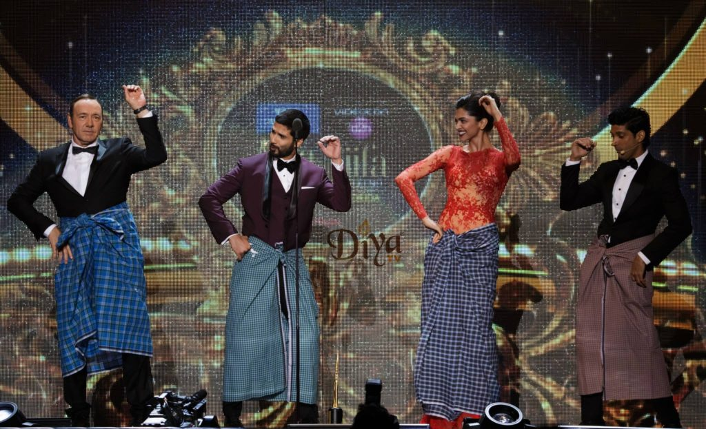 Moments before Deepika Padukone accepted her IIFA, she taught Kevin Spacey how to do the lungi dance. Courtesy: IIFA