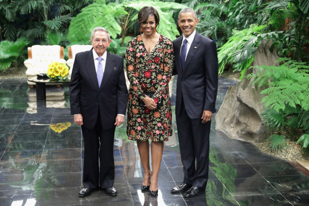 Cuban President Raul Castro with Michelle and Barack Obama before a state dinner at the Palace of the Revolution in Havana, Cuba.