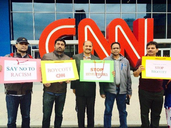 Protestors gather outside CNN headquarters in Atlanta against Reza Aslan's show Believer