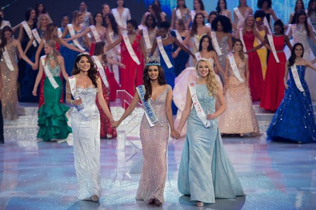 Miss India Manushi Chhilar (C) smiles as she wins the 67th Miss World contest final next to second place, Miss Mexico Alma Andrea Meza Carmona (L), and 3rd place, Miss England Stephanie Jayne Hill (Image: AFP)